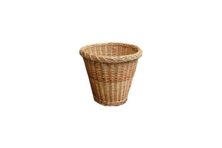 A simple Round Wicker Waste Paper Bin is £loading=