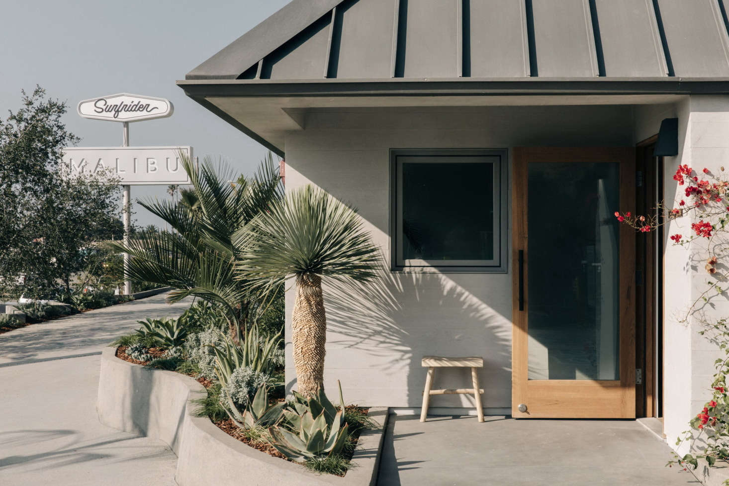 The entrance to The Surfrider, with a retro pitched roof.