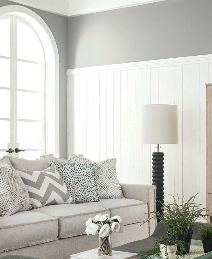 vertical wainscoting accentuates the high ceilings in a living room. for vertic 13