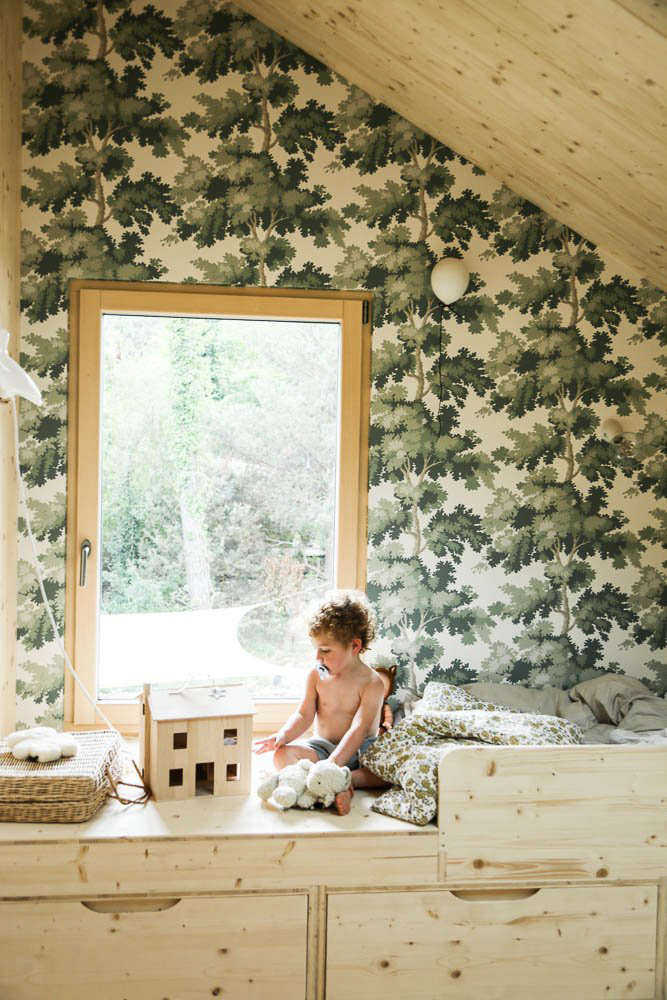 the boillots&#8\2\17; youngest child in his built in bed with storage. the  15