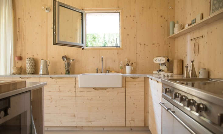 A casement window above the kitchen sink looks out onto the yard.