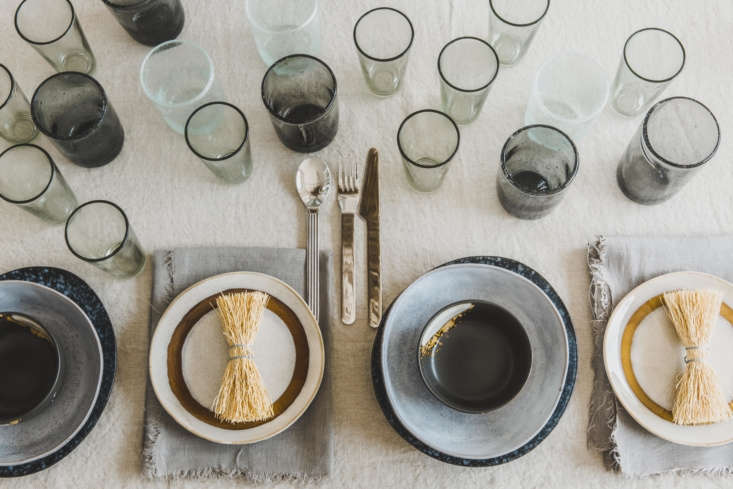 The table is covered with a Washed Linen Tablecloth, $59.99, from H&M Home. A &#8