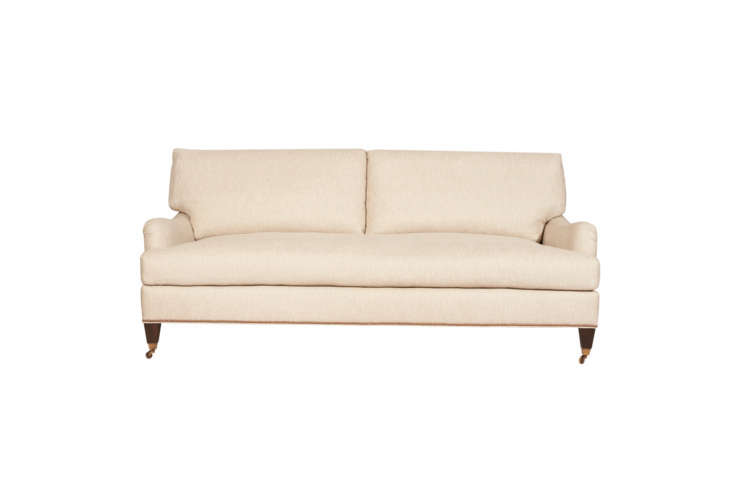 The Cisco Brothers Penelope Sofa is designed with T-cushion arms and antique casters on maple wood. Contact Cisco Brothers for price and dealer information.