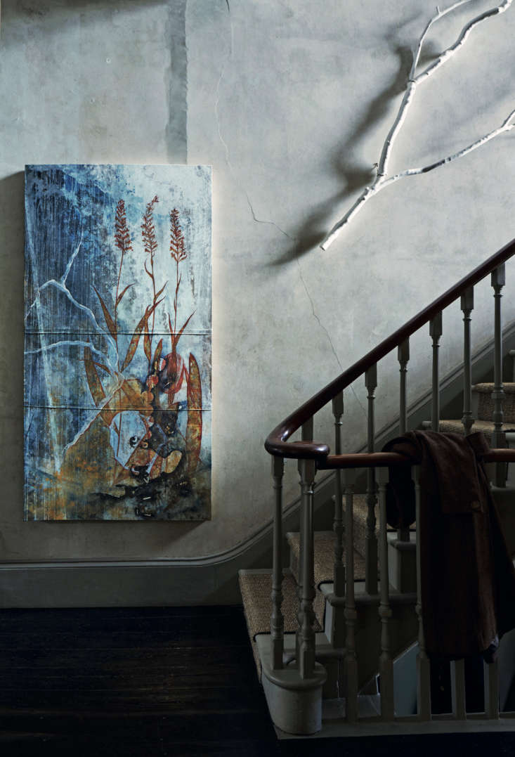 Required Reading An Artist Couples Hauntingly Beautiful Quarters Courtesy of Perfect English Townhouse One of David&#8\2\17;s paintings and a whitewashed branch hang against bare plaster walls in the entry stairwell. David and Anita live several months a year on the Mani Peninsula of Southern Greece, and David says his work is inspired by the area&#8\2\17;s natural landscape and its church wall paintings &#8\2\20;richly patinated in their various states of decay.&#8\2\2\1;