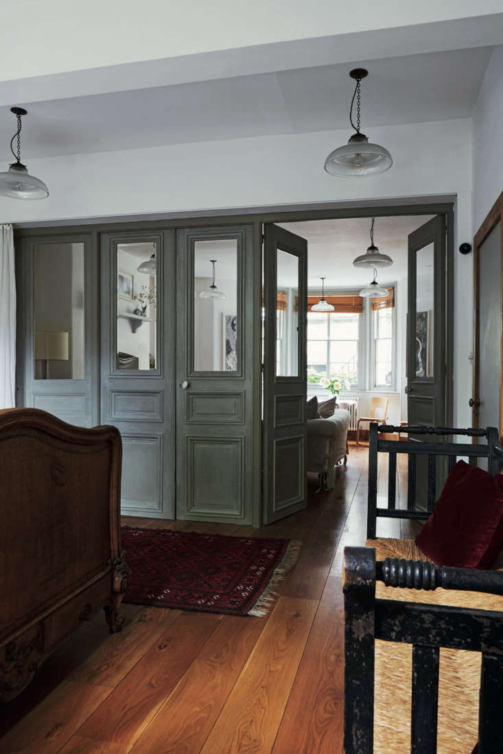 Required Reading An Artist Couples Hauntingly Beautiful Quarters Courtesy of Perfect English Townhouse The couple completely overhauled the garden level basement and turned it into a vacation rental: it&#8\2\17;s available as The Atelier, York via Sawday&#8\2\17;s for £\130 a night. The front sitting room is divided from the bedroom by \18th century château doors that came from a local antiques dealer friend and allow sunlight to travel through the space.