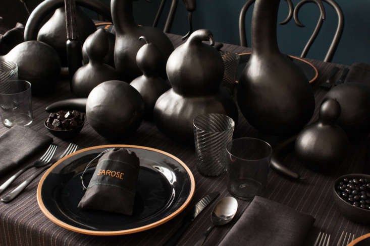 the gloss black ceramic charger plates are from m.crow. the nouvel studio twist 10