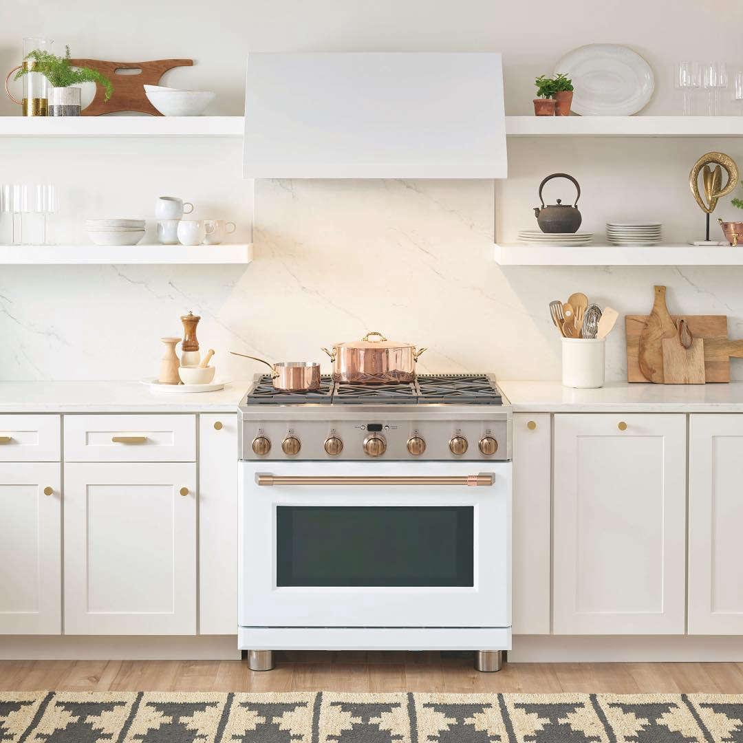 The Café 36-Inch Dual FuelProfessional Range with 6 Burners is available with either a white or black matte finish and a choice of hardware; $7,9 (the same range is available at AJ Madison for $6,473). The Café 36-Inch Commercial Hood is $src=