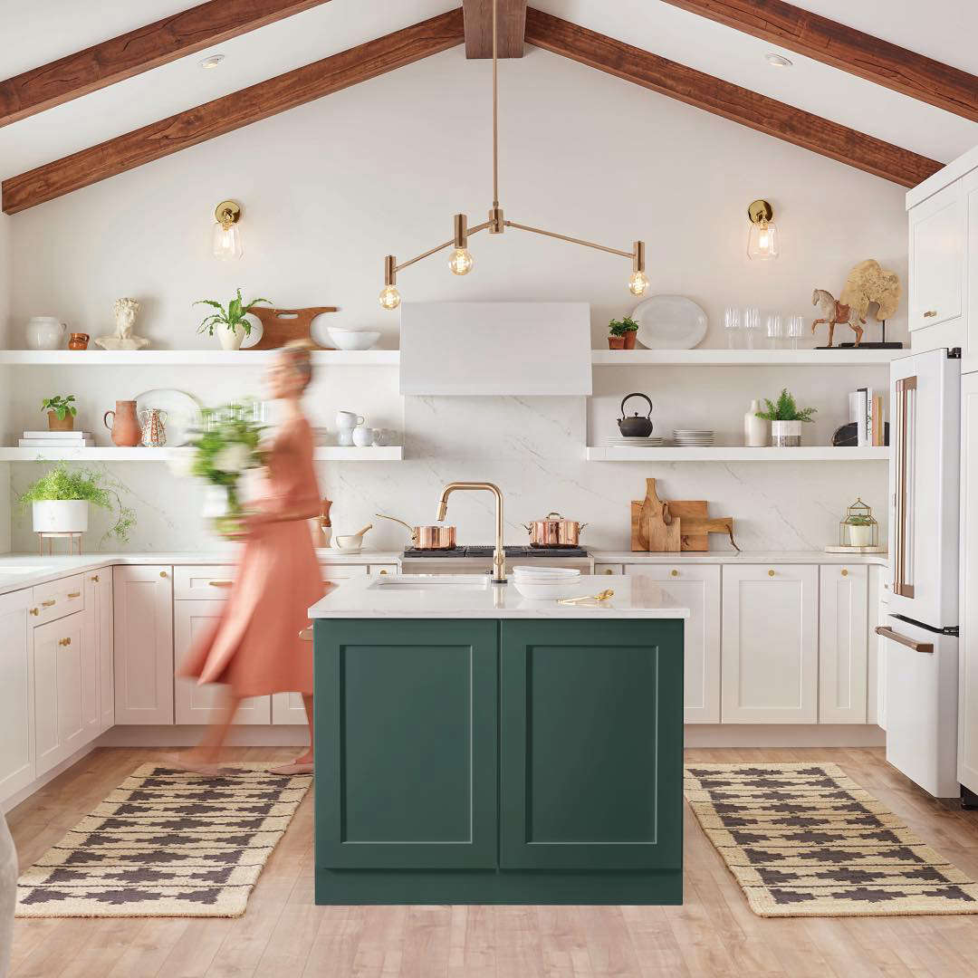A full-kitchen installation ofCafé Range appliances in matte white with brushed copper hardware. Note: AJ Madison offers a Four-Piece GE Café Kitchen Appliance Package that includes a refrigerator, 36-inch gas range, 36-inch vent hood, and dishwasher for $,367.