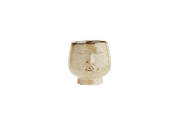 the glazed ceramic peaceful face flower pot, also by rockett st. george, is a m 14