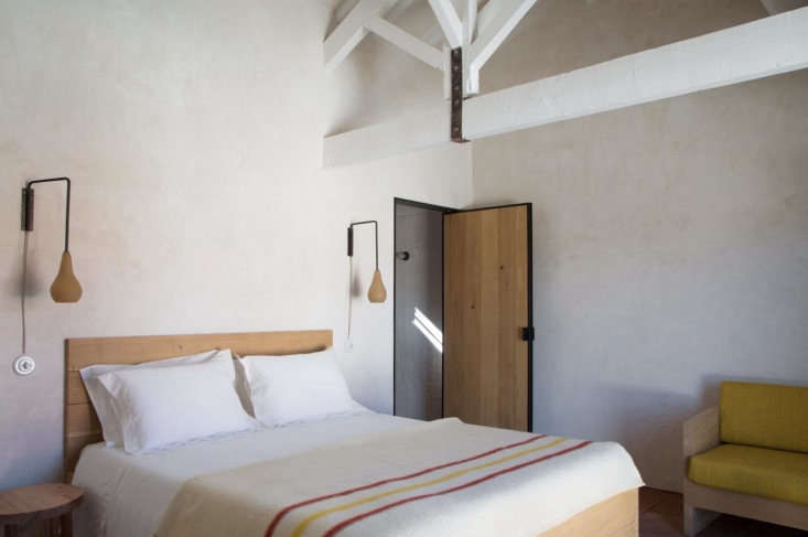 Sculptural Minimalism A Winery Guesthouse by a French Architect in Portugals Douro Valley Another guest bedroom, with embroidered bed linens and subtle dashes of color.