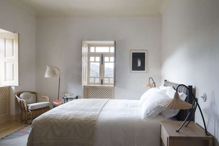 Each bedroom is fitted with rattan lamps, mix-and-match patterned blankets, and a rotary phone, an indication of the property&#8