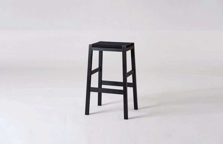 The Simple Stoolhas a black Shaker tape seat.