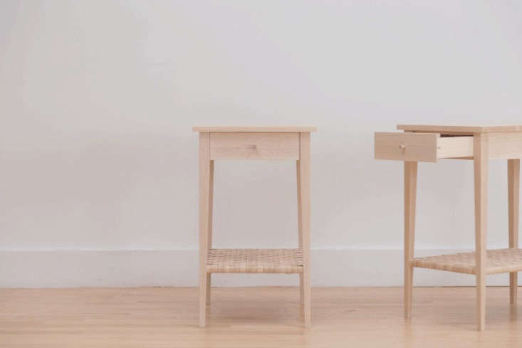 A pair of Splint Side Tables, with thoughtful details: leather-lined drawers, copper-peg joinery, and woven shelves inspired by the Shakers.