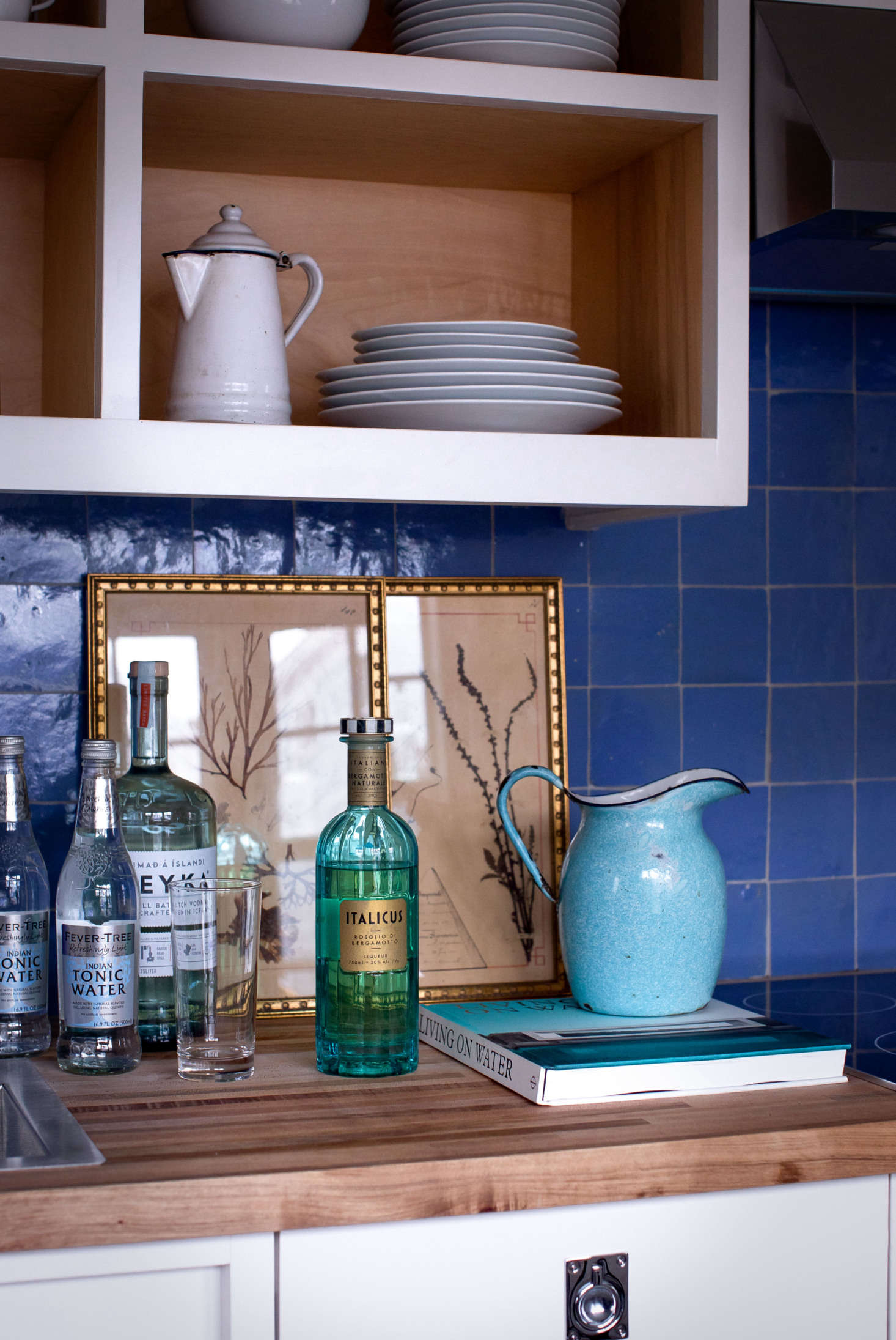 The small studio kitchenette features Cle Tile&#8