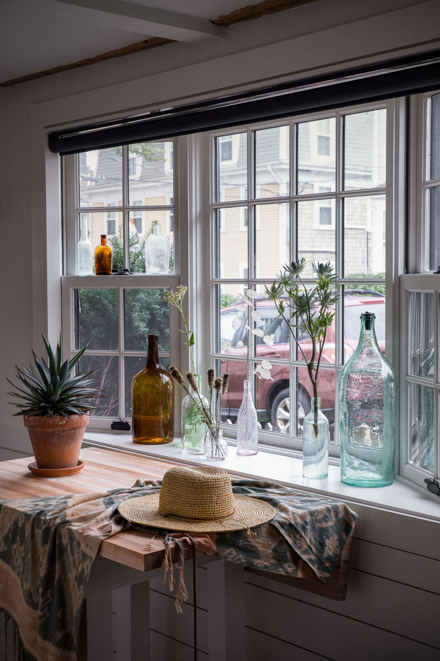 The studio is illuminated by a generous bay window that overlooks bustling Commercial Street.