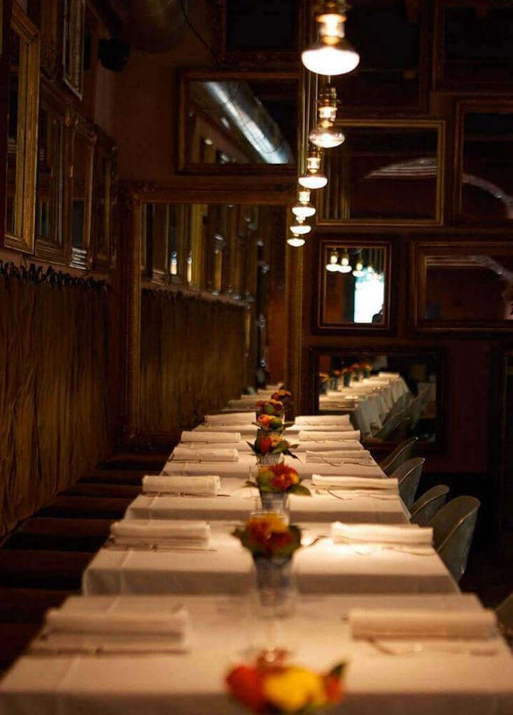 Tables are set with heavy Italian linens.