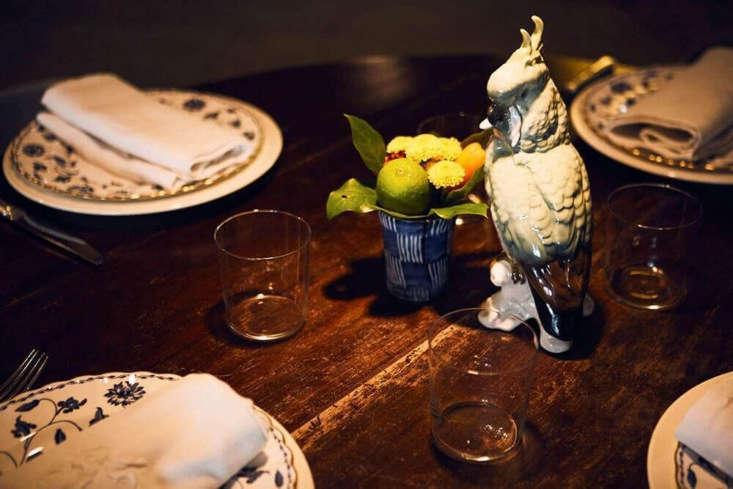 Animal-themed ceramics anchor each table.