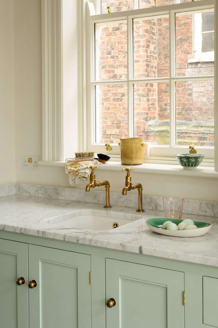 To the bewilderment of some Americans who have visited, we outfitted the butler's sink with deVol's  Aged Brass Mayan Taps. Why not a mixer faucet? Because we liked the look, only to discover that it's an undeniable daily pleasure to turn a tap and get ice cold water without any waiting or adjustments.