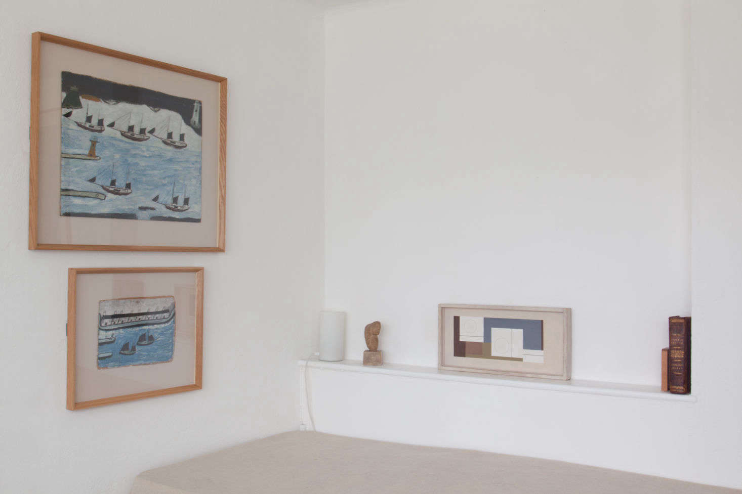 Propped on the shelf next to the twin bed is the Ben Nicholson 4src=