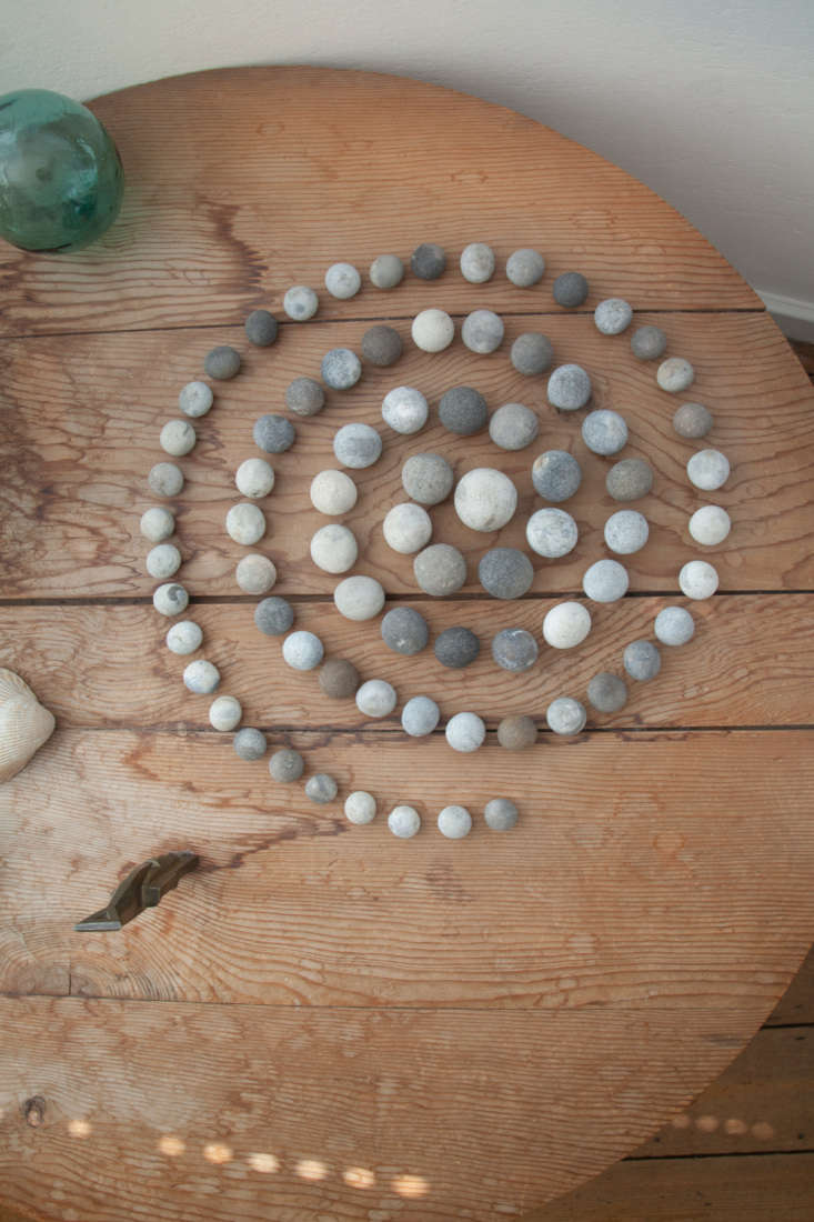 Acollection of round stones gathered by Ede (most likely on the beaches of Cardiff) are arranged in a spiral pattern, with the largest stone at the center and the smallest on the outer edges.