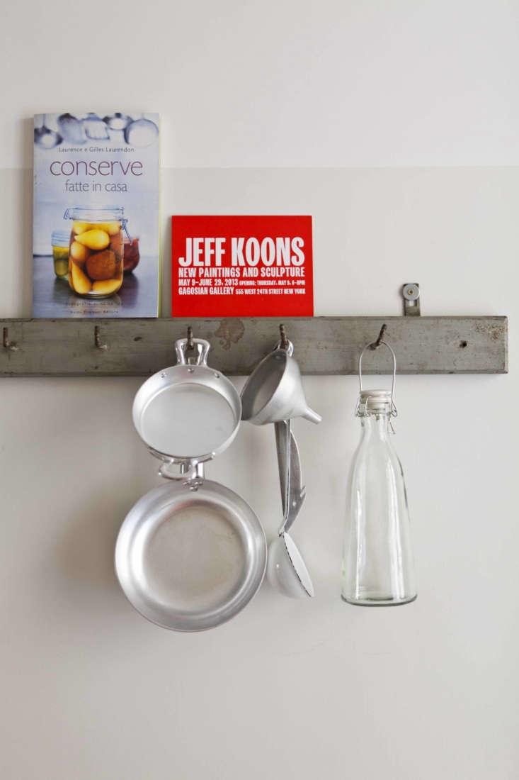 hooks hold kitchen ephemera. 19