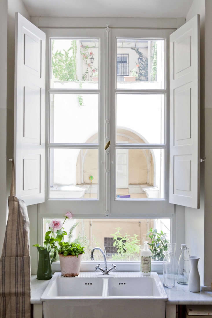 The architects positioned the Ikea sink beneath the window, overlooking the Roman street. (A similar model, available in the US, is the Havsen Apron-Front Double-Bowl Sink.)