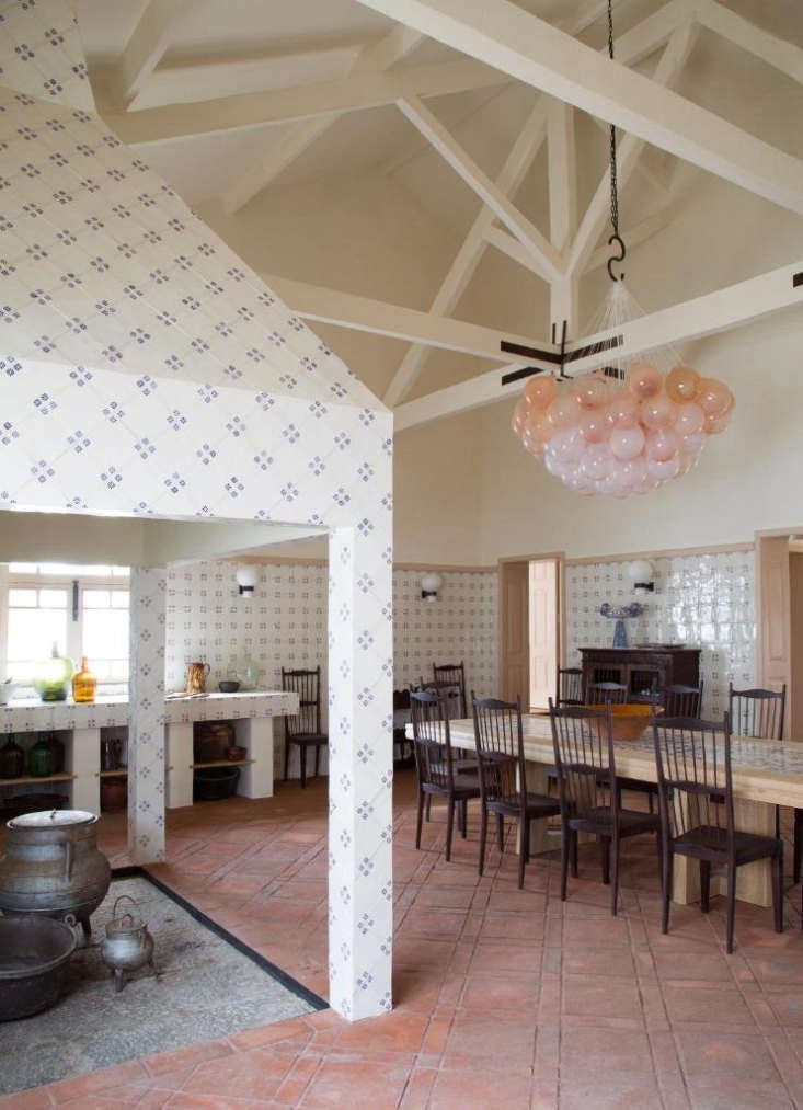 Sculptural Minimalism A Winery Guesthouse by a French Architect in Portugals Douro Valley In the combined kitchen and dining room, walls are tiled in traditional Portugueseazulejos.For the pale pink glass light installation, Yovanovitch collaborated with Swiss glassmakerMatteo Gonet.