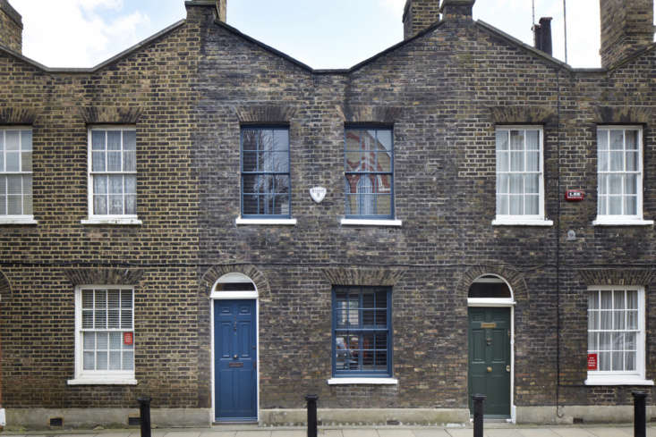 the house is the one with the blue door and window frames. much of it, from bas 9