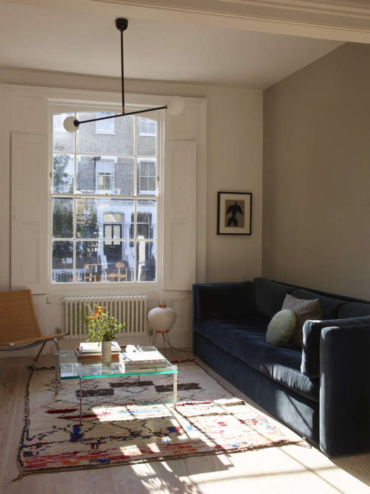 A Noguchi table light placed on the floor is an unexpected touch. Photograph by Richard Round-Turner, courtesy of Lisa Jones, from A Star Is Born: A Rehabbed London Maisonette from a Newly Minted Designer, High/Low Secrets Included.