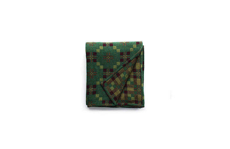 Welsh Coast Traditional Wool Blankets in Unexpected Palettes from Melin Tregwynt The St. David&#8\2\17;s Cross Throw in Pine, a rich reversible green; £\149 from Another Country.