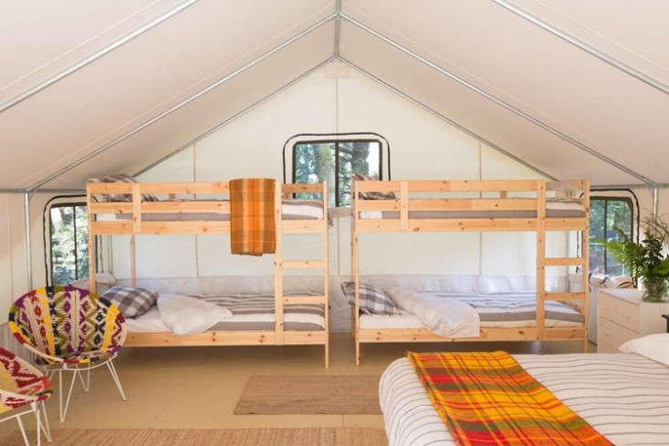 a family tent, with bunks and plaid blankets. 12