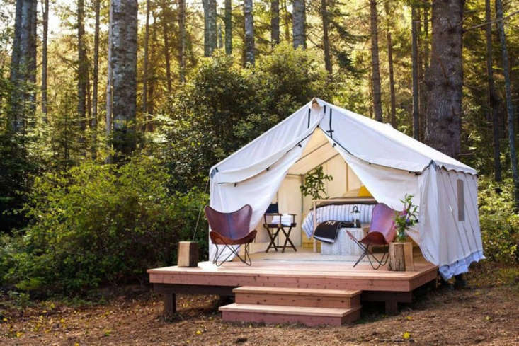 the tents are perched on platforms that extend into a private deck made of redw 10