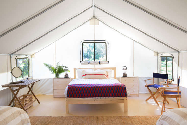 inside one of the larger tents: a simple wood bed frame (for a similar one, see 11