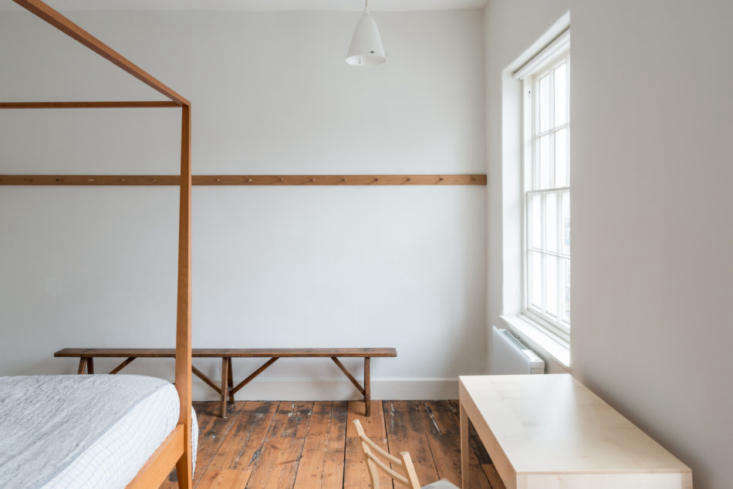 a peg rail, a remodelista storage favorite, bisects one wall of the bedroom. (s 19