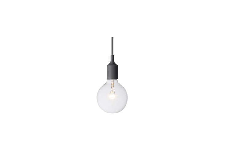 Anstruther hung a trio of Muuto E Ceiling Light Fixtures in black ($79 each from YLighting) over her kitchen island.