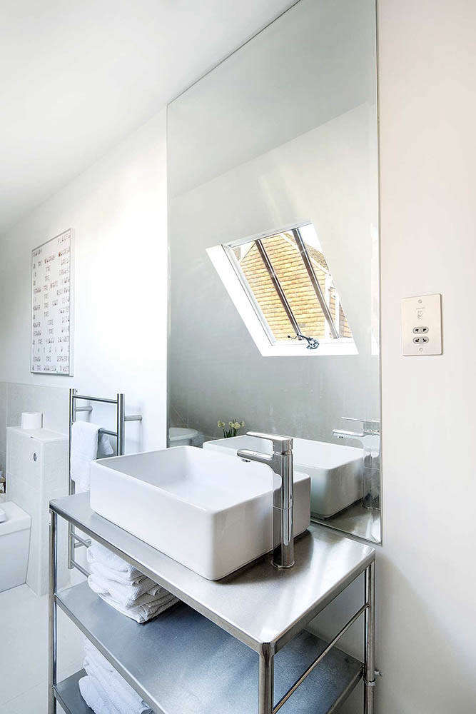Bathroom in St. John's Ambulance Conversion by Marta Nowicka in East Sussex