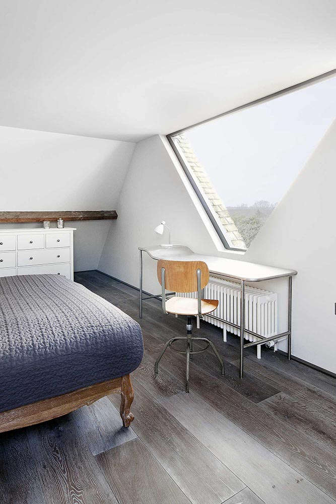 Upstairs Bedroom in St. John's Ambulance Conversion by Marta Nowicka in East Sussex