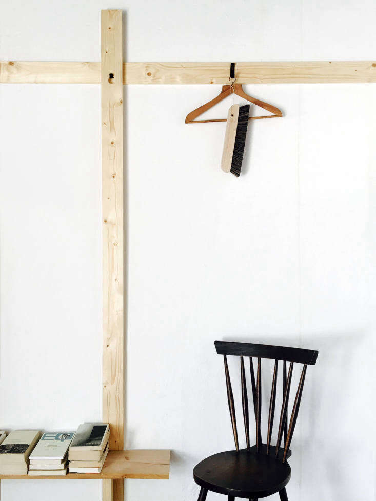 Lessons in Sparseness A Black and White House in Rural Portugal with Echoes of the Shakers Removable black hooks turn the simple lengths of wood into storage.
