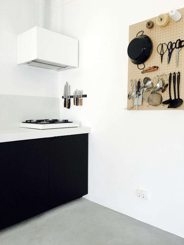 Lessons in Sparseness A Black and White House in Rural Portugal with Echoes of the Shakers By the small gas cooktop is a well appointed pegboard, which holds kitchen shears and even a silver pitcher.