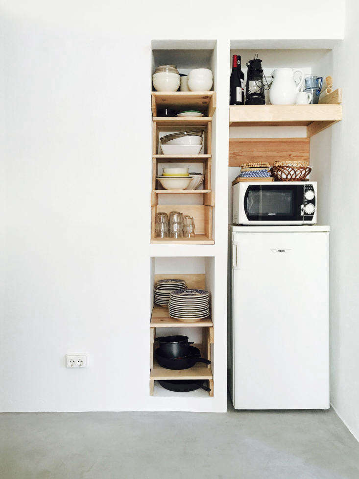 Lessons in Sparseness A Black and White House in Rural Portugal with Echoes of the Shakers Bento chose waxed woodwork as a third main material, and it&#8\2\17;s a theme repeated throughout the house. Here, it forms ad hoc open storage in a niche beside the European sized refrigerator.