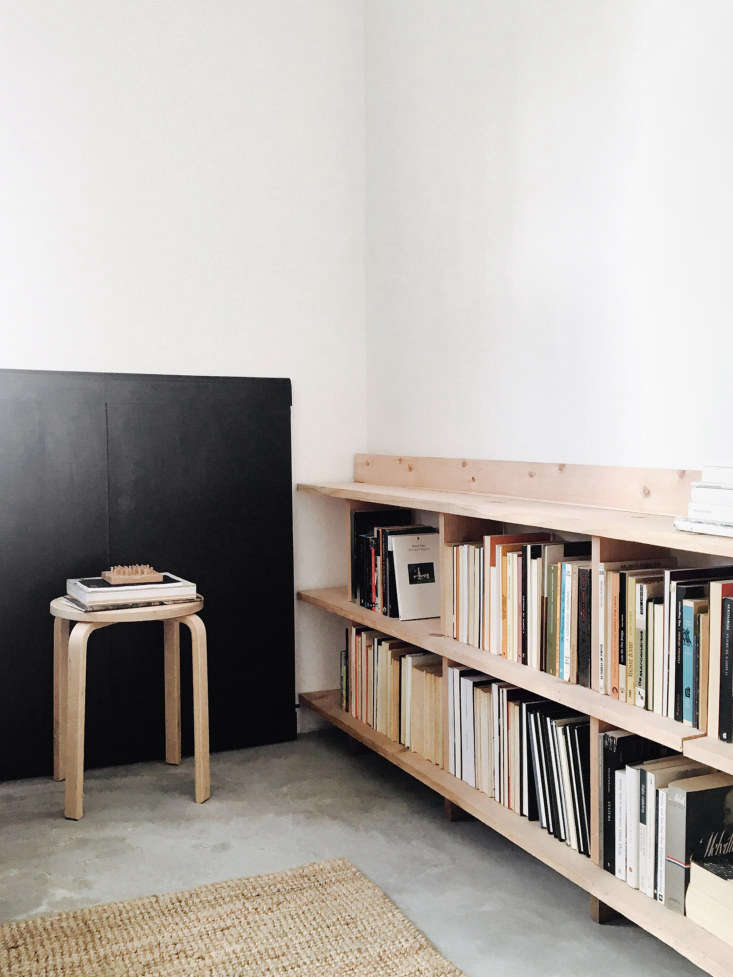 Lessons in Sparseness A Black and White House in Rural Portugal with Echoes of the Shakers In one corner, an Alvar Aalto lookalike stool serves as an end table. Against the wall is an extension for the dining table that doubles as&#8\2\20;vague wainscoting.&#8\2\2\1;