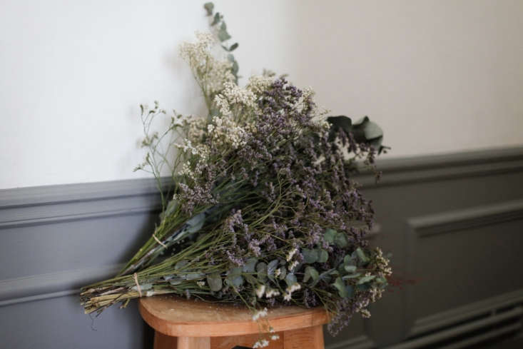 Bundles of dried gypsophila, eucalyptus, and limonium in one of our all-time favorite posts:Done/Undone with Clarisse Demory in Paris.