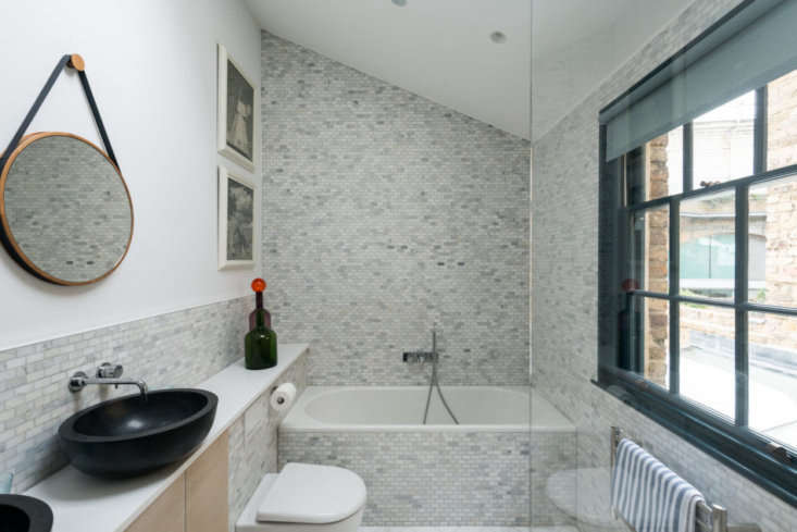 the kitchen&#8\2\17;s marble mosaic tiles reappear in the master bath, wher 20