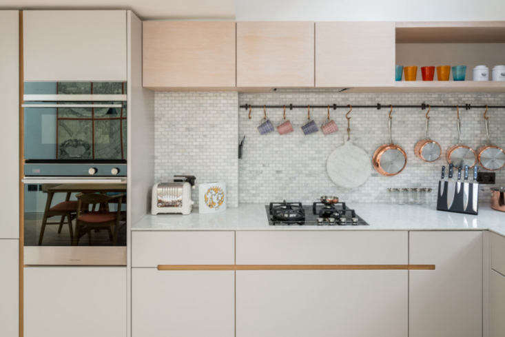 upper cabinets of white oiled douglas fir conceal the range hood and provide ex 16