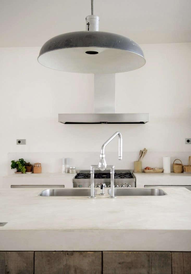 Designer Roxane Beis sourced an oversized vintage industrial pendant for a Paris loft; tour the kitchen atDesigner Visit: Paris Meets Provence.