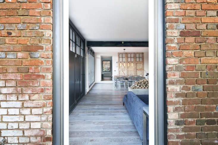 The garage doors were remade to meet building regulations, but Nowicka kept the originals, stripping them back and using them as wall cladding.