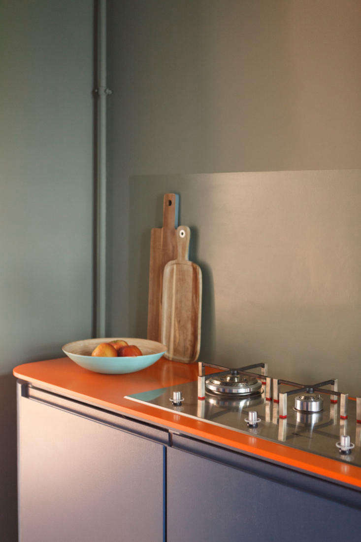 concealed within the custom cabinets are the refrigerator, gas heater, and dish 15