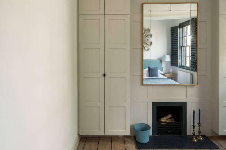 the bedroom&#8\2\17;s closets are incorporated into paneling that surrounds 19