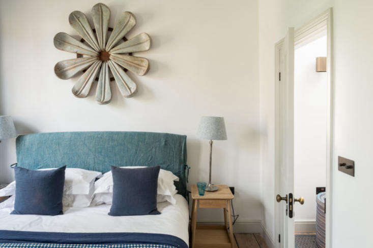 a whimsical floral art piece is mounted to the wall in the master bedroom. 18
