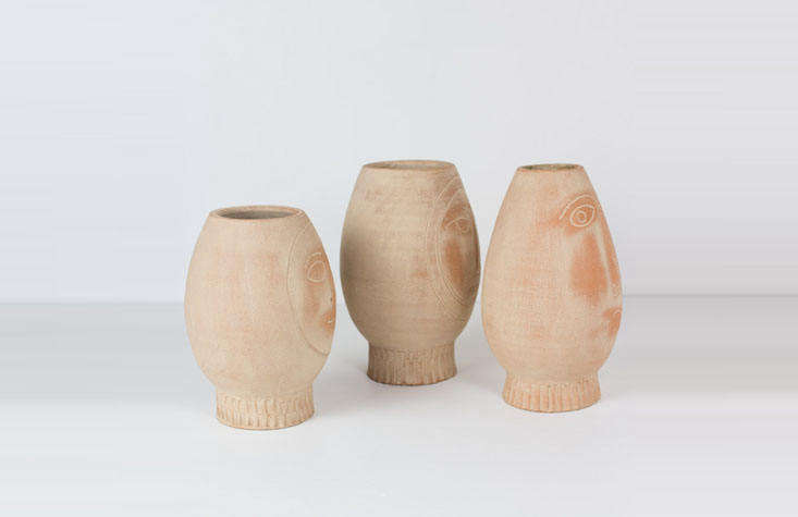 the pots, sleuthed; a set of three clay face pots are \$90 from at west end. 10
